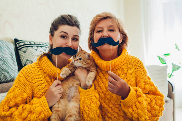 Senior mother and her adult daughter taking selfie with cat using picture id1147587853?b=1&k=6&m=1147587853&s=612x612&w=0&h=l0kcu9z iq8x99quqzpygiwiynodqi12np0n18anmuk=