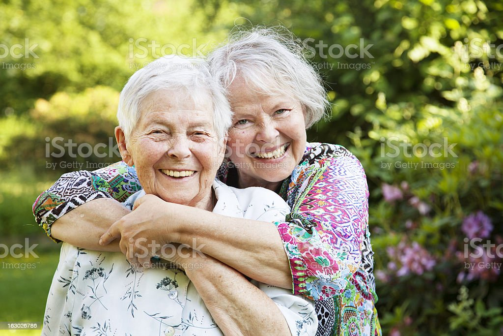 senior mother and mature daughter togetherness stock photo