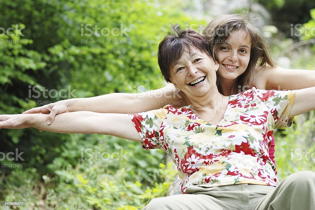 Senior mother enjoys life with her daughter royalty-free stock photo