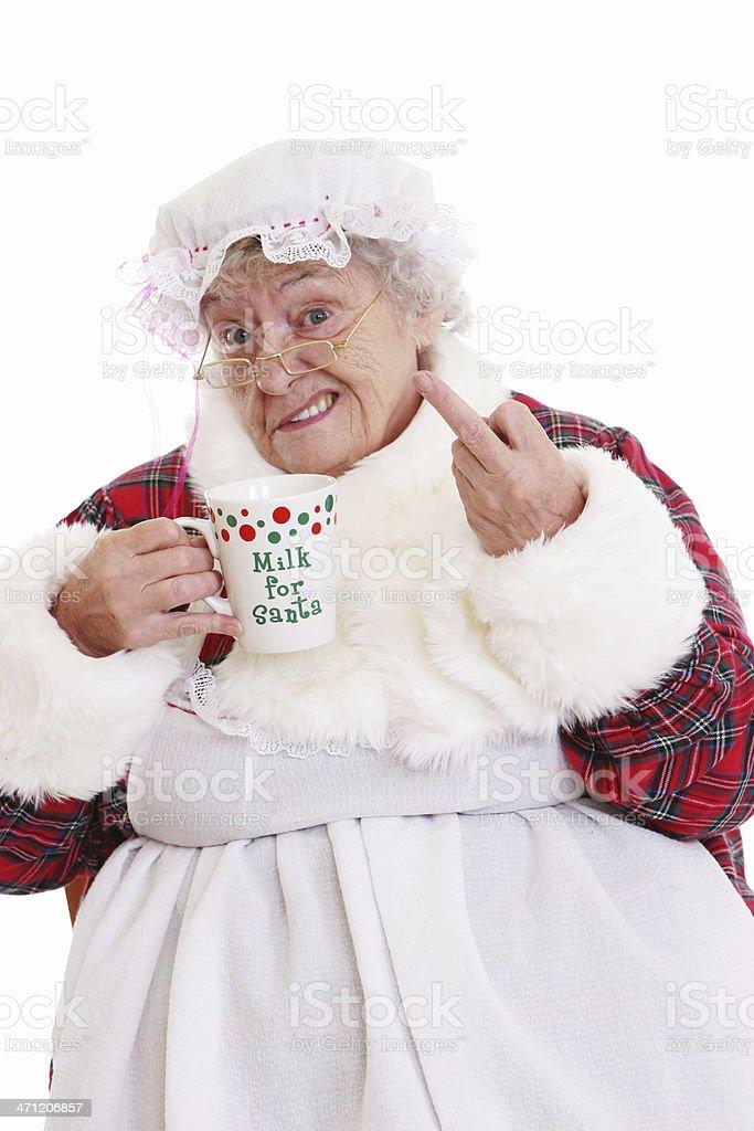 Senior Mrs Claus drinking Santa's milk and flipping the bird stock photo