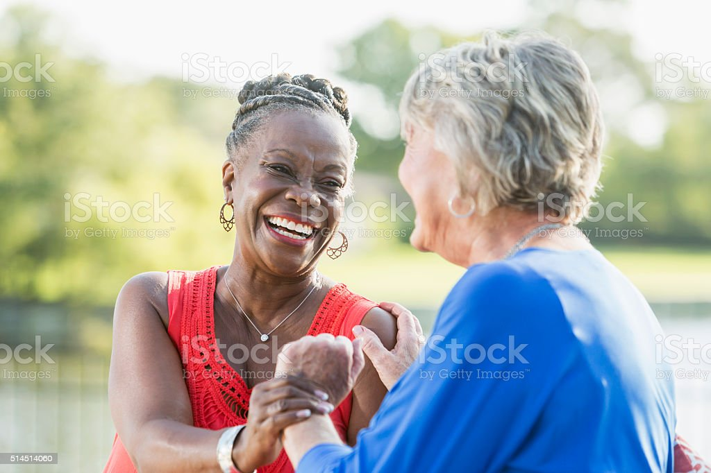 Senior multi-racial women, best friends,  laughing stock photo