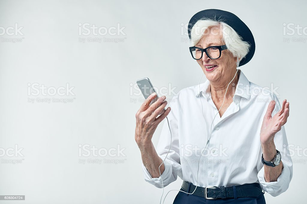 Senior music lover with smartphone stock photo