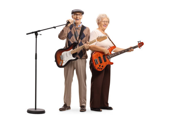 Senior musicians with electric guitar and a microphone stock photo