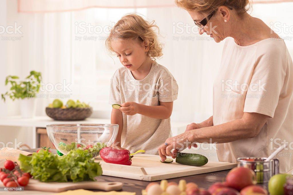 Senior nanny cooking with child photo libre de droits