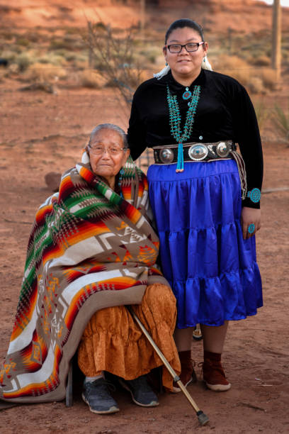 senior native american grandmother with teenage granddaighter - navajo culture stock photos and pictures