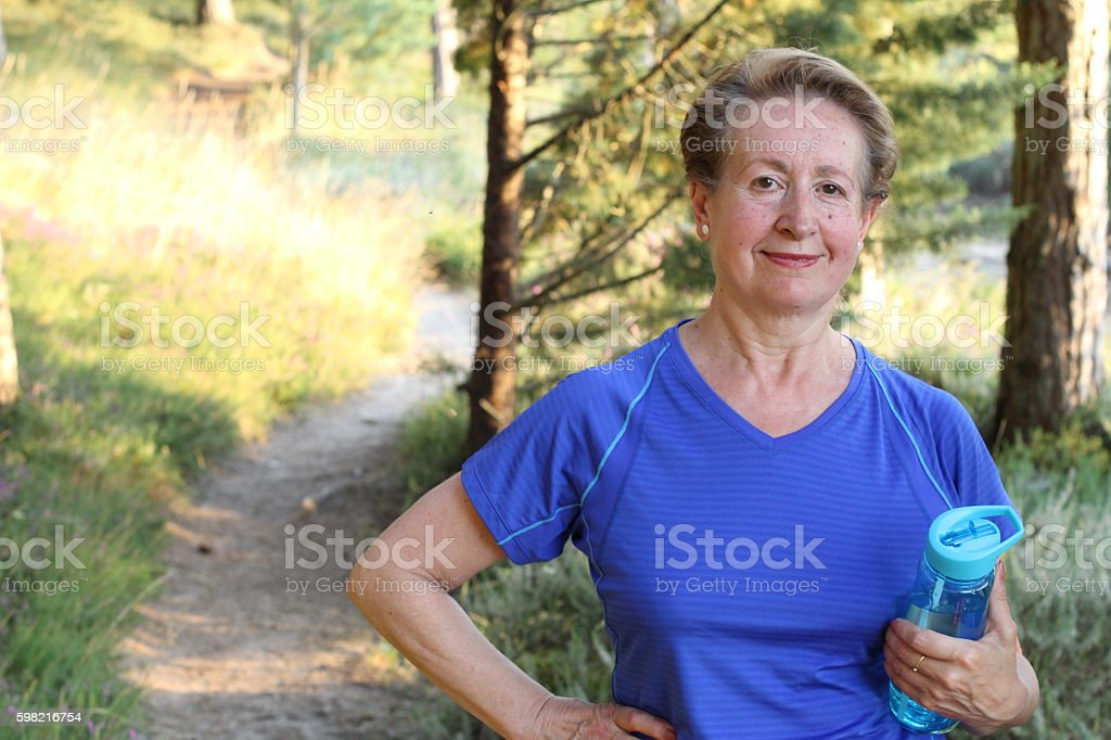 Senior Natural Woman Relaxing After Exercise stock photo