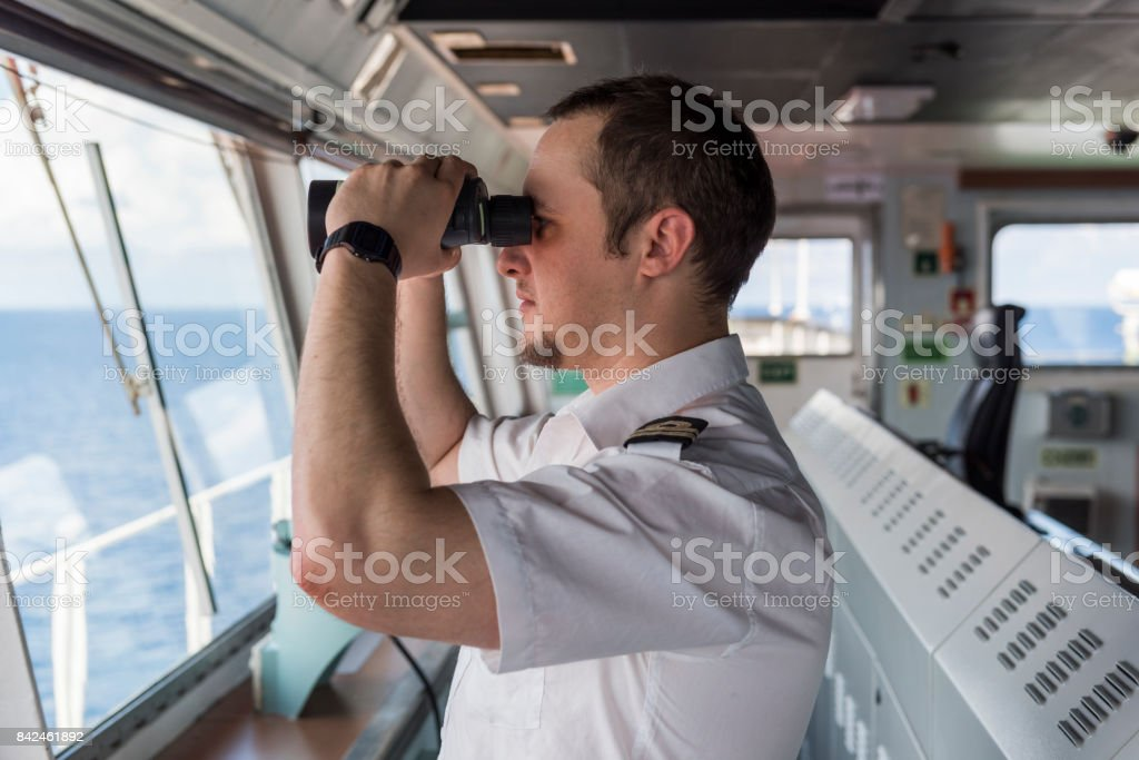 Senior Navigation Officer Navigating his Ship stock photo