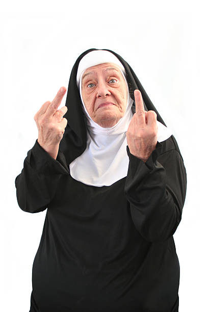 senior nun giving two middle finger gestures, isolated on white - swearing stockfoto's en -beelden