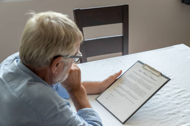 Senior old man elderly examining and checking last will and testament Senior old man elderly examining and checking last will and testament last stock pictures, royalty-free photos & images