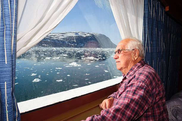 Senior on cruise in Greenland stock photo