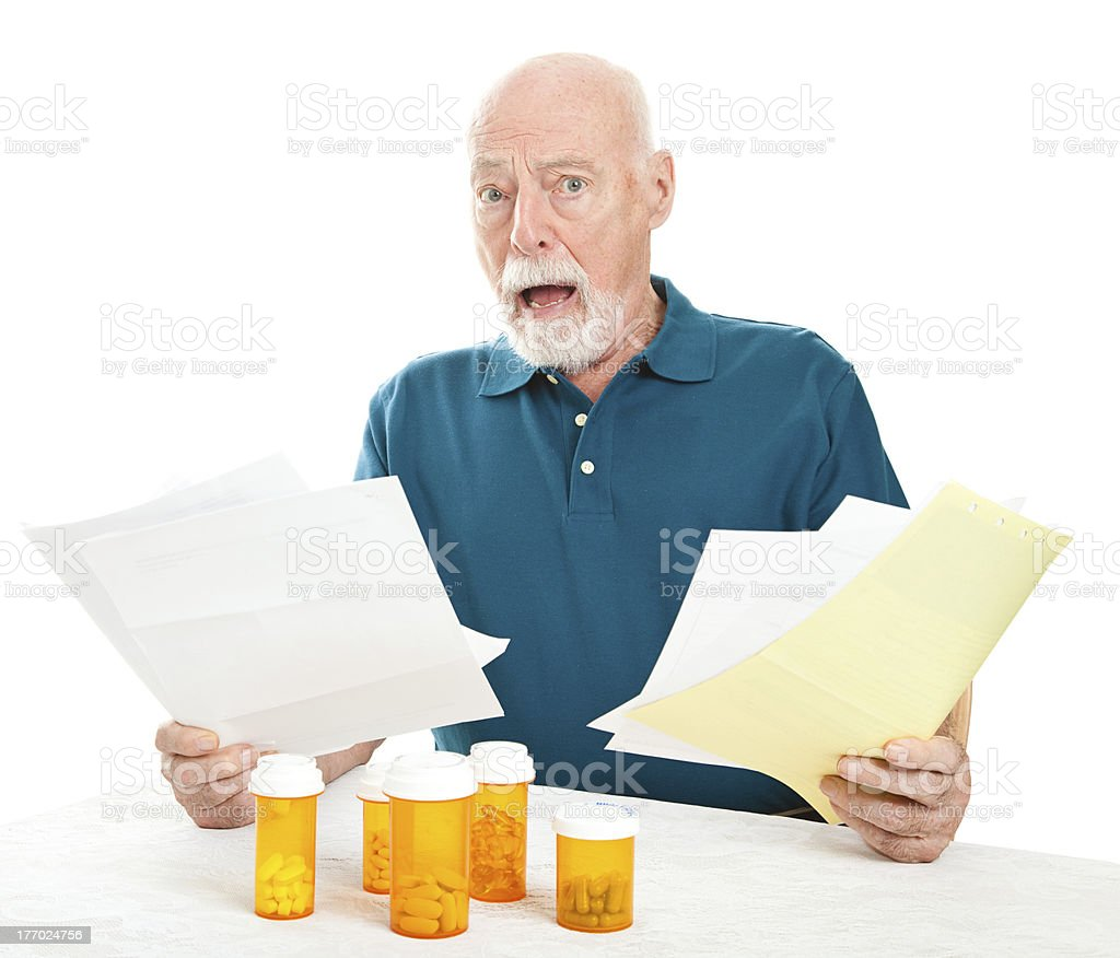 Senior Overwhelmed by Medical Costs stock photo