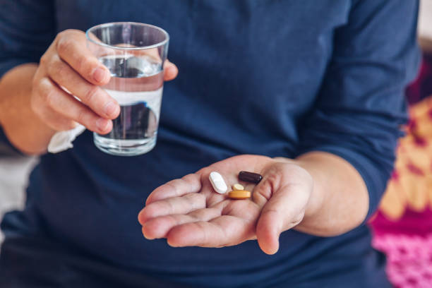 Senior painkiller treatment stock photo