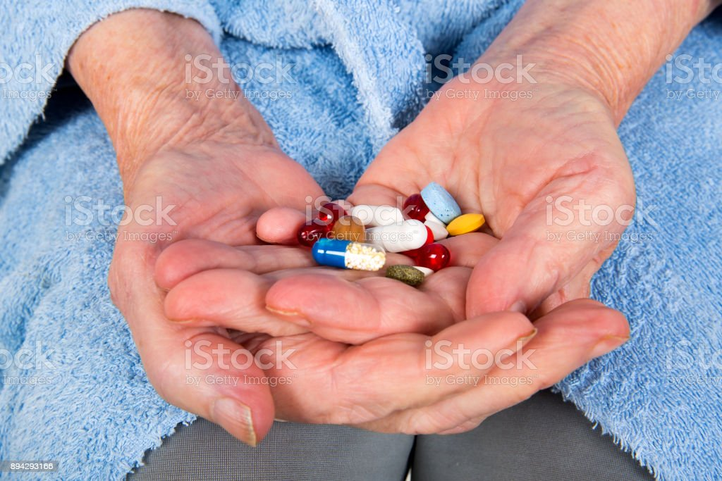Senior painkiller treatment stock photo