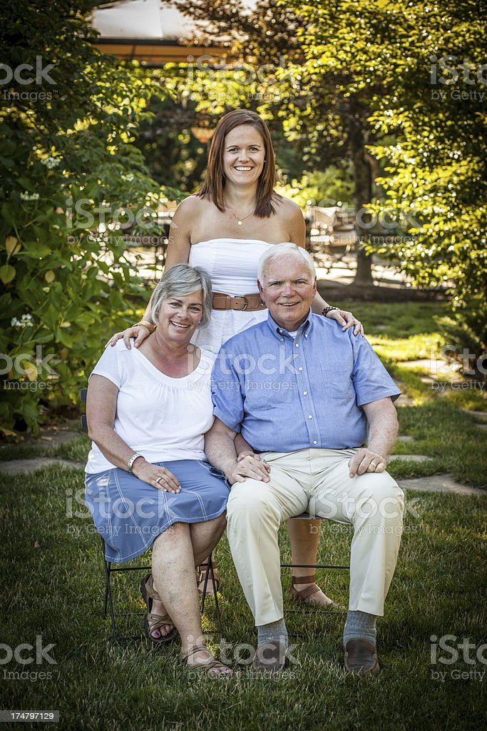 Senior Parents with Daughter at a Beautiful Park royalty-free stock photo