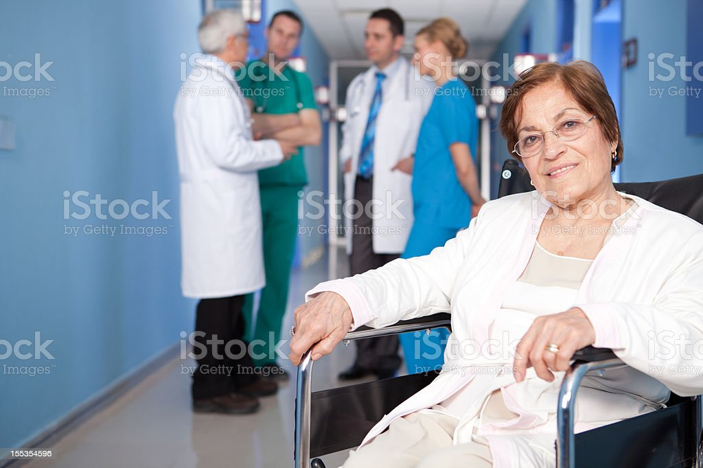 Senior Patient and Healthcare Workers royalty-free stock photo