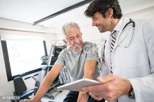 istock Senior patient asking questions to his physician about his recovery plan 912333710
