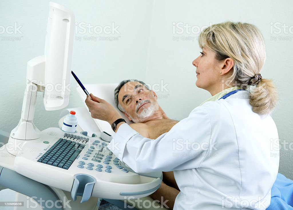 Senior patient getting ultrasound from doctor royalty-free stock photo