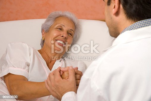 Senior Patient Holds Hands With Male Doctor Stock Photo & More Pictures of Adult