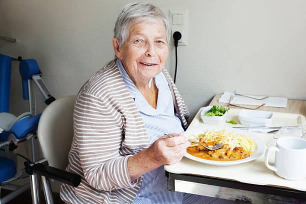 senior patient hospital eating stock photo