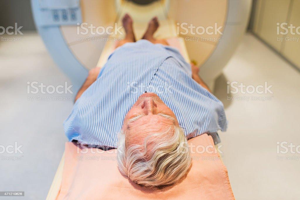 Senior patient receiving an MRI Scan. stock photo