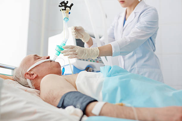 Senior patient respiratory care Senior patient with endotracheal tube life support machine stock pictures, royalty-free photos & images