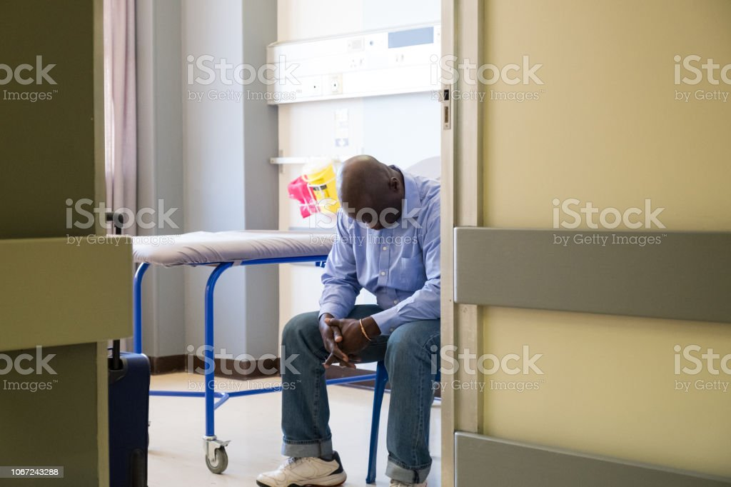Senior patient waiting in his hospital room stock photo