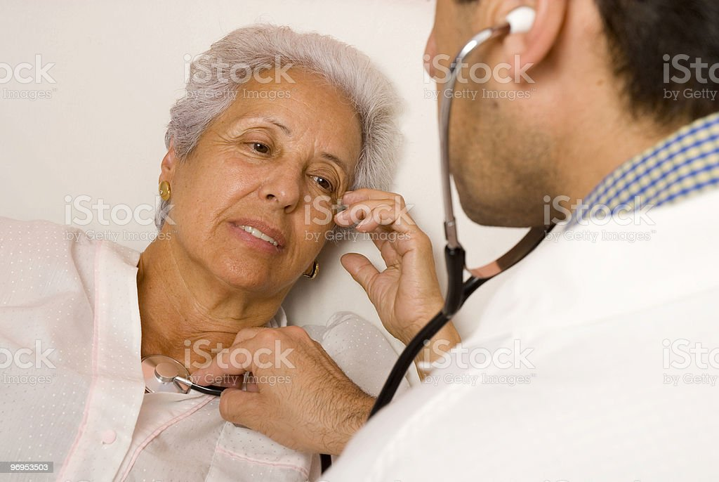 Senior patient with a doctor royalty-free stock photo