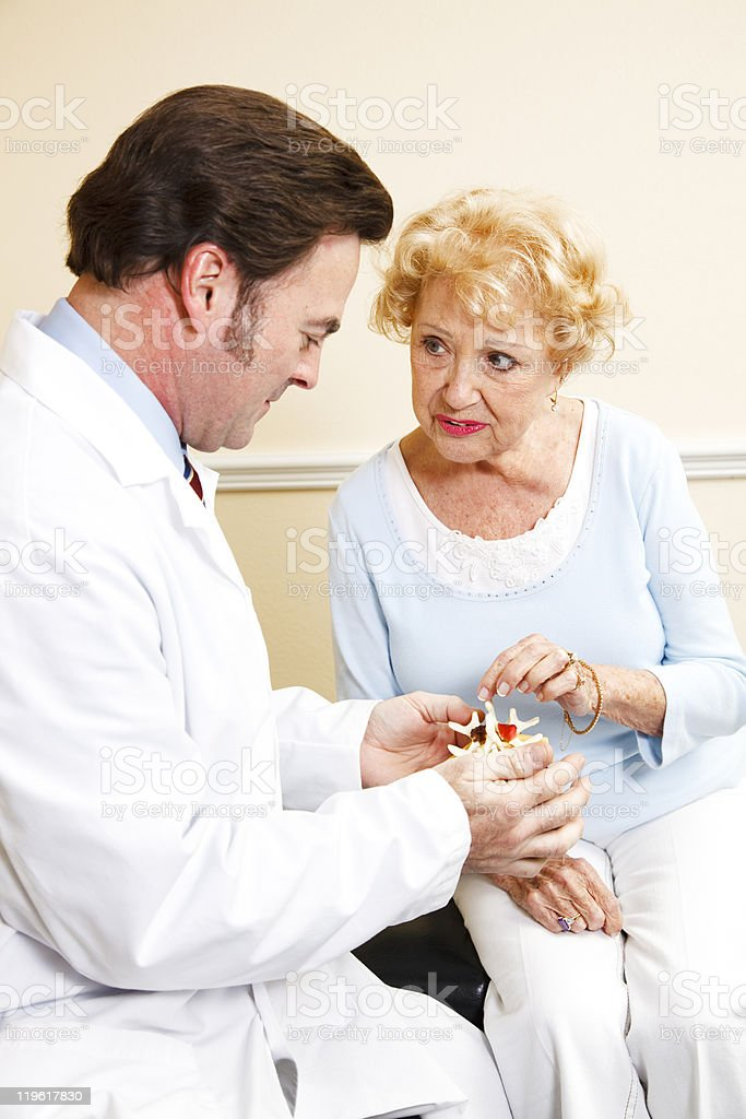 Senior Patient with Chiropractor royalty-free stock photo