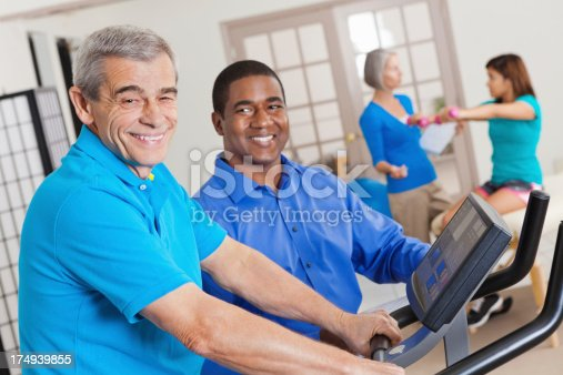 912333752 istock photo Senior patient with physical therapist in rehabilitation gym 174939855