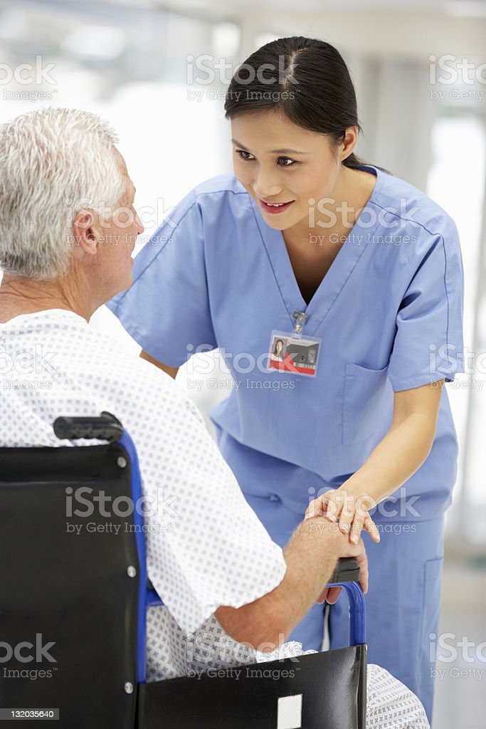 Senior patient with young doctor stock photo