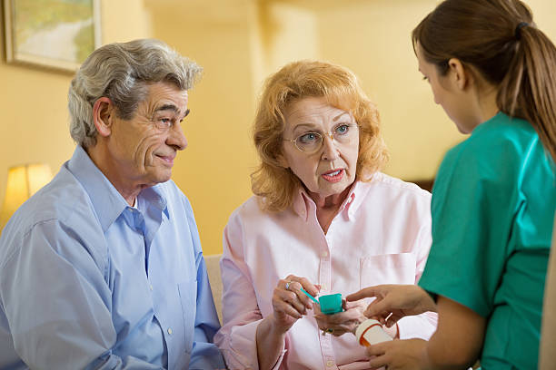 senior patients asking questions about medication to home healthcare nurse - question mark asking doctor nurse stock photos and pictures