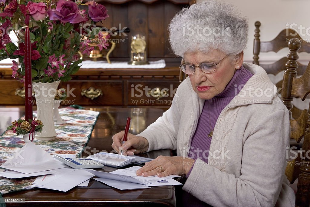 Senior Paying the Bills royalty-free stock photo