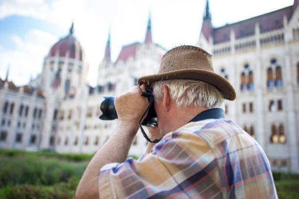 Senior pensioner photographing parliament building budapest picture id820875128?b=1&k=6&m=820875128&s=612x612&w=0&h=xu00j0yhzclm 8gbprnp9xwufqwjp03h1ndjoro7  u=
