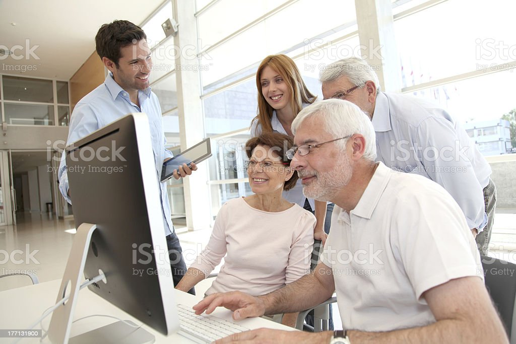 Senior people attending business training stock photo