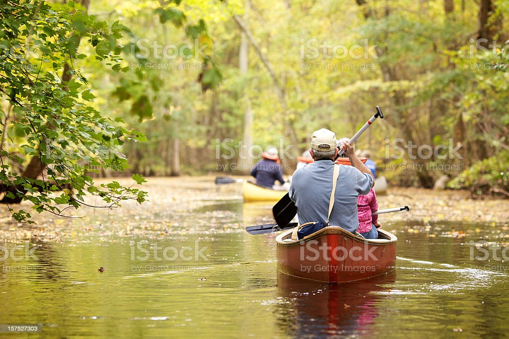 senior people canoeing royalty-free stock photo