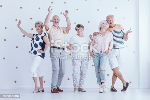 istock Senior people dancing each other 892948850