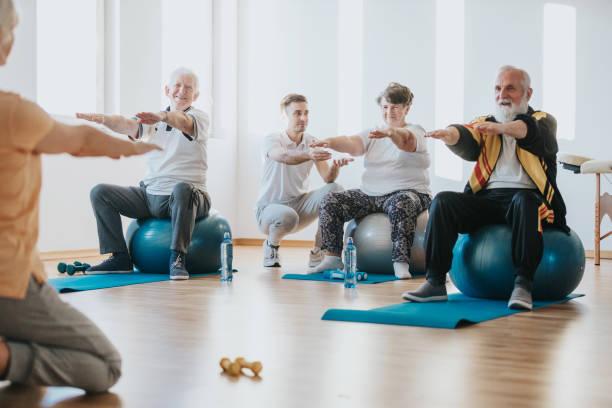 Senior people exercising stock photo