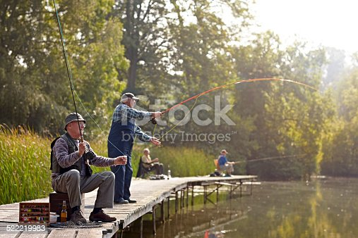 483319252istockphoto Senior people fishing at the river 522219983