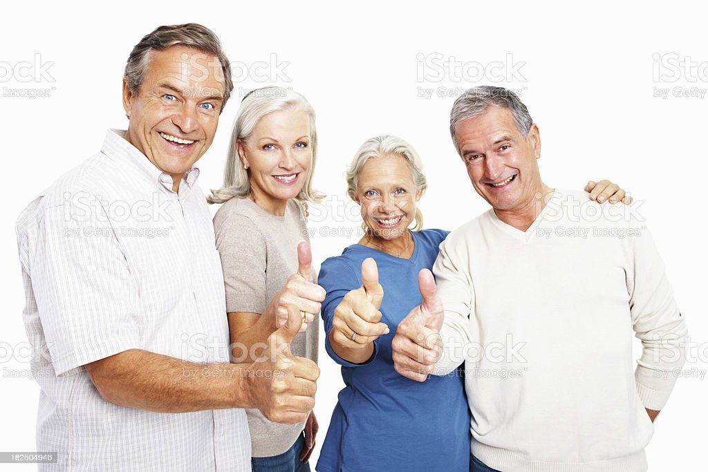 Senior people giving thumbs up sign over white royalty-free stock photo