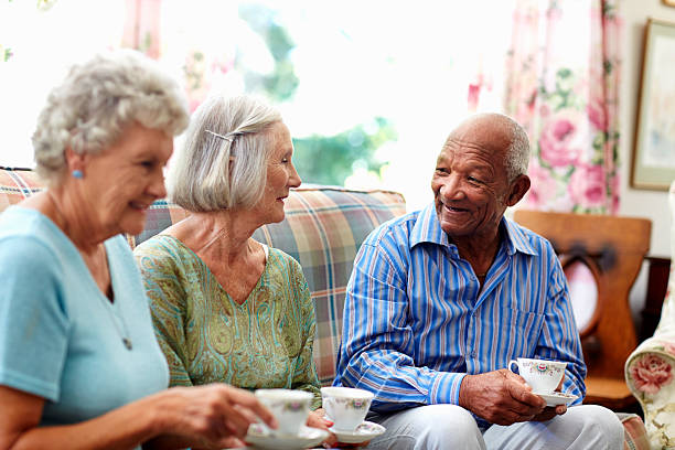 Senior people having coffee Happy senior people having coffee in nursing home retirement community stock pictures, royalty-free photos & images