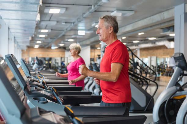 senior people having rehabilitation at fitness club - runner rehab gym foto e immagini stock