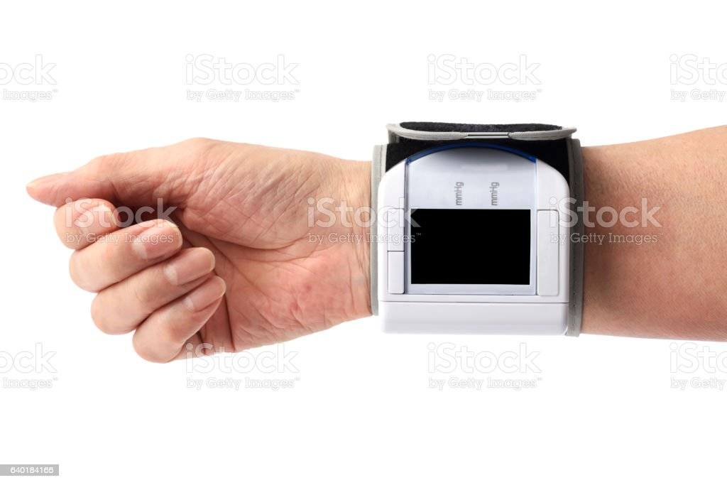 Senior People measuring blood pressure at home on white background stock photo