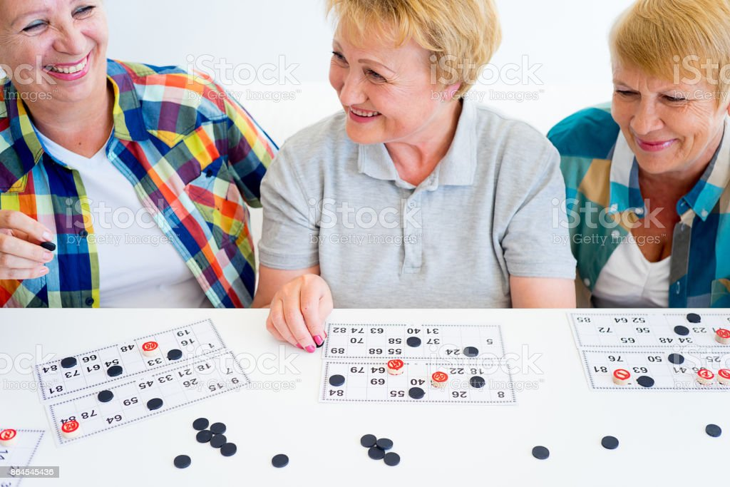 Senior people playing board games stock photo