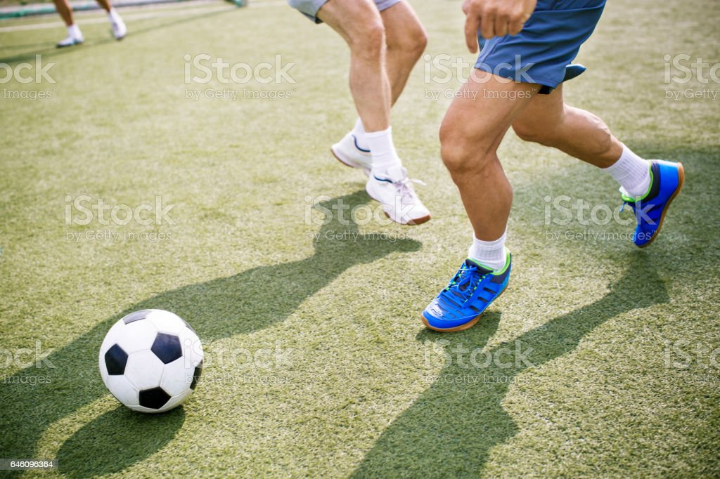 Senior people playing soccer stock photo
