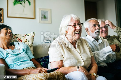 istock Senior people watching television together 1043564886