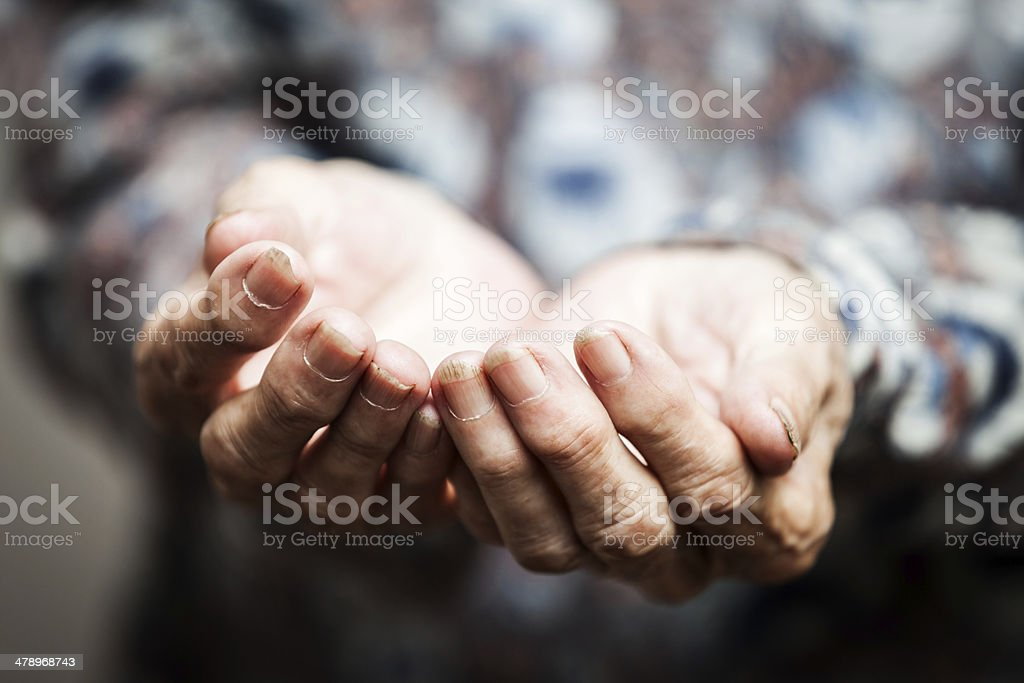 Senior person hands begging for food or help stock photo