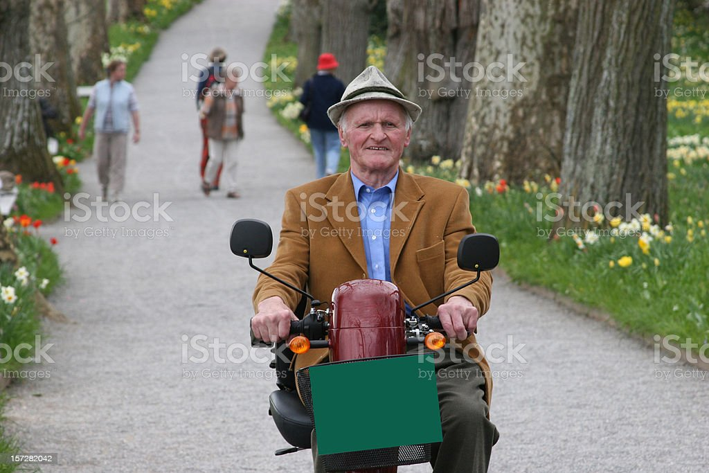 Senior person on a electric motorbike stock photo