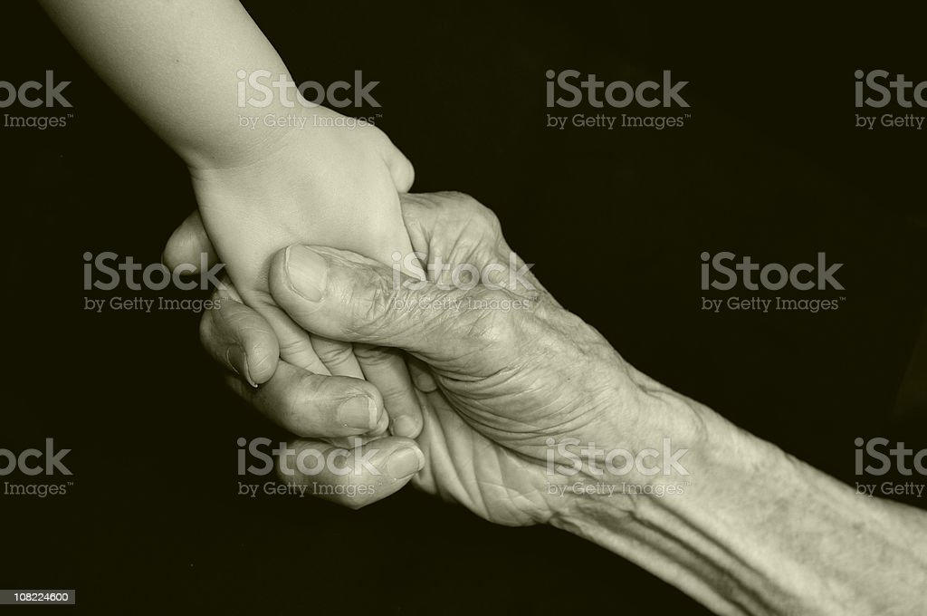 Senior Person's Gripping Child's Hand, Black and White stock photo
