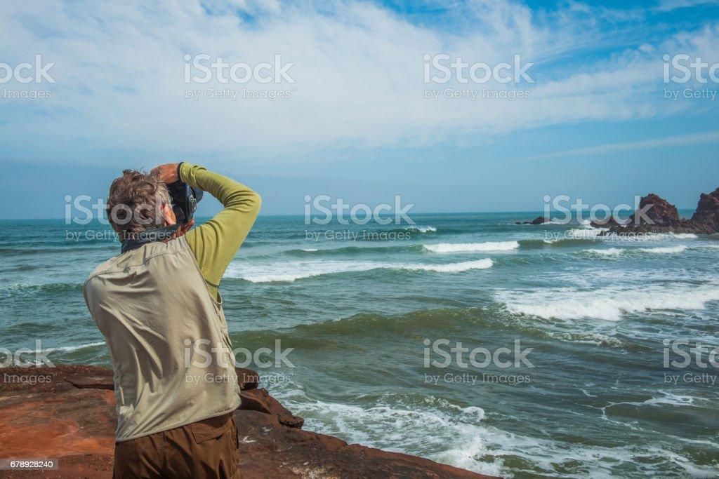 Senior Photographer on Legzira Beach, Sidi Ifni, Morocco, Africa stock photo