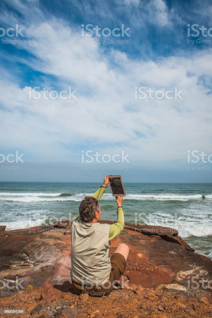 Senior Photographer on the Atlantic Coast, Legzira, Sidi Ifni, Morocco, North Africa stock photo